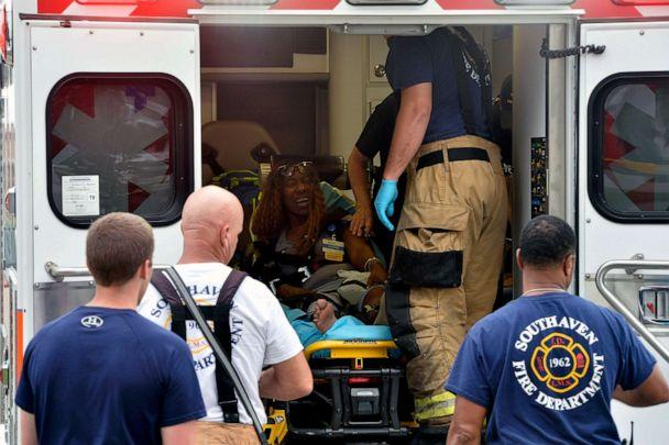 PHOTO: A Walmart employee receives medical attention after a shooting at the store, July 30, 2019, in Southaven, Miss. (Brandon Dill/AP)