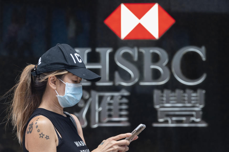 HONG KONG, CHINA - 2020/09/22: A woman wearing a mask stands in front of the British multinational banking and financial services holding company HSBC Bank seen in Hong Kong. (Photo by Miguel Candela/SOPA Images/LightRocket via Getty Images)