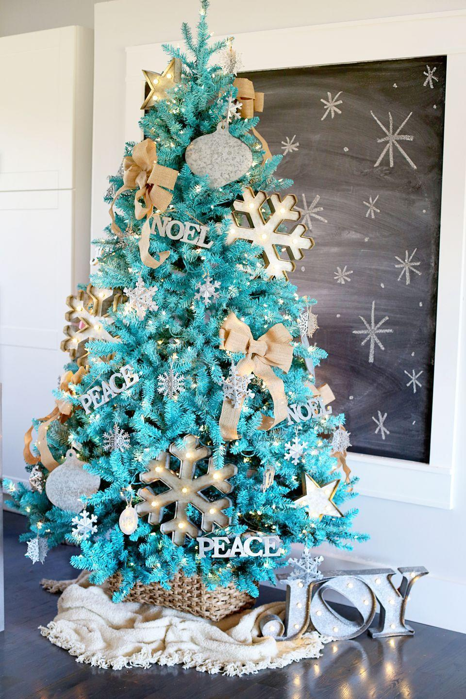 "<p>If Christmas is your favorite holiday, you may find yourself erring toward an exaggerated tree that truly reflects your love of the season. The formula, as proven by <a href=""http://www.sugarbeecrafts.com/2015/11/rustic-modern-dream-tree-reveal.html"" rel=""nofollow noopener"" target=""_blank"" data-ylk=""slk:Sugar Bee Crafts"" class=""link rapid-noclick-resp"">Sugar Bee Crafts</a>: giant ornaments, giant snowflakes, and a tree color that breaks the norm, like <a href=""https://www.elledecor.com/design-decorate/color/a7825/paint-colors-designers-hate/"" rel=""nofollow noopener"" target=""_blank"" data-ylk=""slk:wintry turquoise"" class=""link rapid-noclick-resp"">wintry turquoise</a>. </p>"