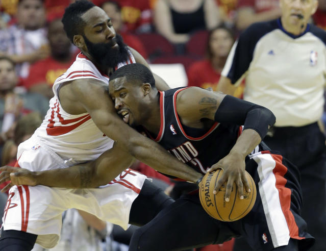 Houston Rockets' James Harden, left, tries to knock the ball away from Portland Trail Blazers' Wesley Matthews (2) in the second half of Game 5 of an opening-round NBA basketball playoff series Wednesday, April 30, 2014, in Houston. The Rockets won 108-98 to send the teams back to Portland for Game 6. (AP Photo/Pat Sullivan)