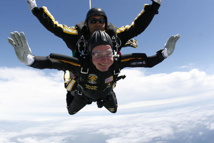 <p>Former President George H.W. Bush (bottom) celebrates his 85th birthday by jumping with the Army's Golden Knight parachute team in a tandem jump with SFC Michael Elliott in Kennebunkport, Maine, on June 12, 2009. (Photo: U.S. Army Parachute Team/Reuters) </p>