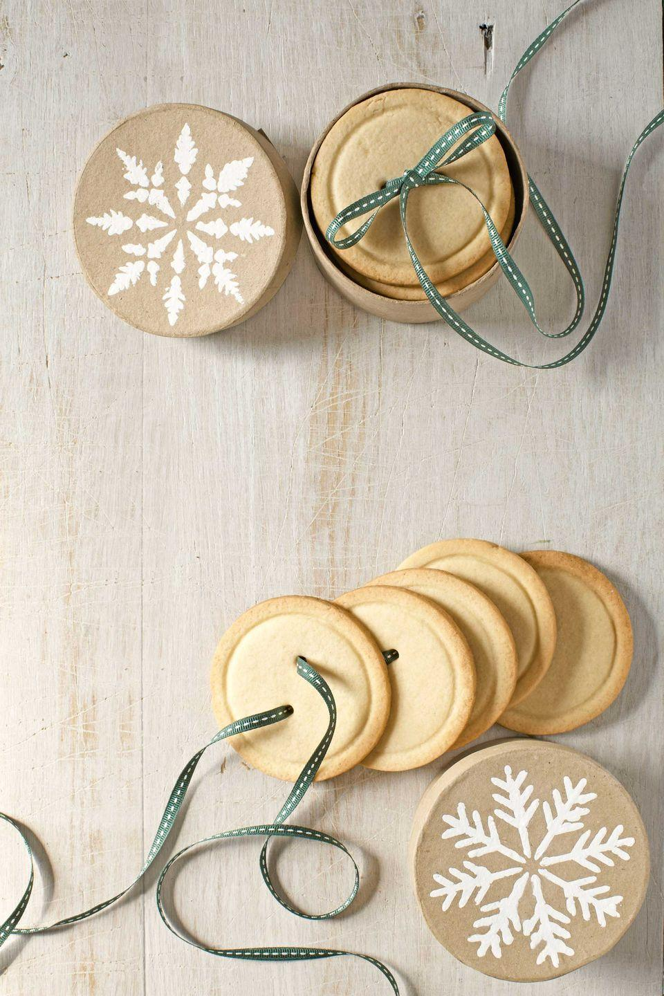 """<p>These buttery delights are cute as, well, you know. Gather a stack together by threading ribbon through the buttonholes, and present the cookies in a perfectly sized papier-mâché box with a snowflake stenciled on the lid.</p><p><strong><a href=""""https://www.countryliving.com/food-drinks/recipes/a4272/sugar-cookie-buttons-recipe-clv1212/"""" rel=""""nofollow noopener"""" target=""""_blank"""" data-ylk=""""slk:Get the recipe"""" class=""""link rapid-noclick-resp"""">Get the recipe</a>.</strong></p>"""