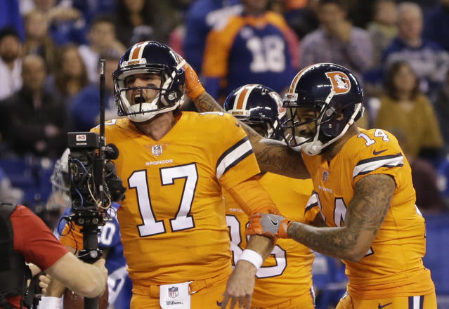 Denver Broncos quarterback Brock Osweiler (17) celebrates his rushing touchdown against the Colts. (AP)