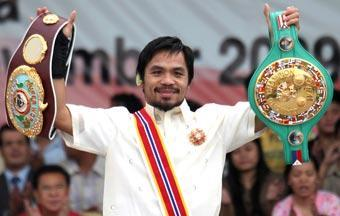 Manny Pacquiao shows his championship belts as he is conferred the Order of Sikatuna, one of the highest awards given to diplomats and state leaders, by Philippine Pres. Gloria Macapagal Arroyo in Nov
