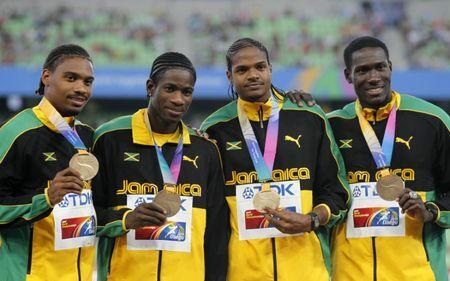 Bronze medalists Allodin Fothergill, Jermaine Gonzales, Riker Hylton and Leford Green of Jamaica (L to R) stand on the podium after their men's 4x400 meters relay event at the IAAF World Championships in Daegu September 3, 2011. REUTERS/Lee Jae-Won