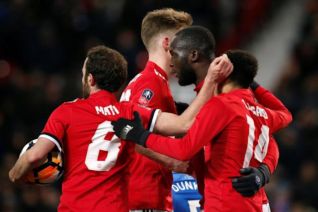 Soccer Football - FA Cup Quarter Final - Manchester United vs Brighton & Hove Albion - Old Trafford, Manchester, Britain - March 17, 2018 Manchester United's Romelu Lukaku celebrates scoring their first goal with team mates REUTERS/Andrew Yates
