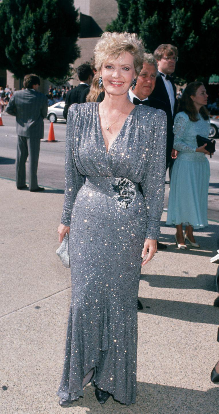 <p>The stunning Carol Brady actor wore a glittery, powder blue dress that did not go light on the shoulder pads.</p>