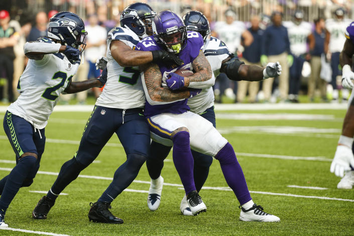 Minnesota Vikings tight end Tyler Conklin (83) is tackled by Seattle Seahawks middle linebacker Bobby Wagner (54) in the first half of an NFL football game in Minneapolis, Sunday, Sept. 26, 2021. (AP Photo/Bruce Kluckhohn)