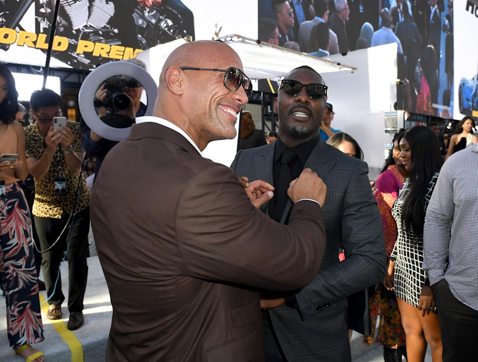 """HOLLYWOOD, CALIFORNIA - JULY 13: (L-R) Dwayne Johnson and Idris Elba arrives at the premiere of Universal Pictures' """"Fast & Furious Presents: Hobbs & Shaw"""" at Dolby Theatre on July 13, 2019 in Hollywood, California. (Photo by Kevin Winter/Getty Images)"""