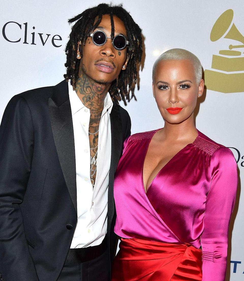 """<p>The couple began dating in 2011, and Rose even got the rapper's face tattooed on her arm. They got married in July 2013, then had a very public breakup, with <a href=""""https://people.com/celebrity/amber-rose-accuses-wiz-khalifa-of-cheating/"""" rel=""""nofollow noopener"""" target=""""_blank"""" data-ylk=""""slk:Rose publicly accusing Khalifa of cheating"""" class=""""link rapid-noclick-resp"""">Rose publicly accusing Khalifa of cheating</a>. They've given fans reasons to think they were back together, although the couple finally <a href=""""https://pagesix.com/2018/05/25/amber-rose-denies-wiz-khalifa-reconciliation/"""" rel=""""nofollow noopener"""" target=""""_blank"""" data-ylk=""""slk:shut the reconciliation rumors down"""" class=""""link rapid-noclick-resp"""">shut the reconciliation rumors down</a> in 2018.</p>"""