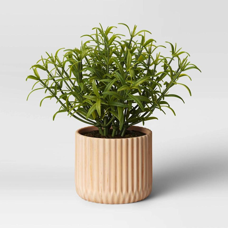 <p>Add texture to your garden with this <span>Opalhouse Indoor/Outdoor Faux Wood Planter Beige</span> ($30).</p>