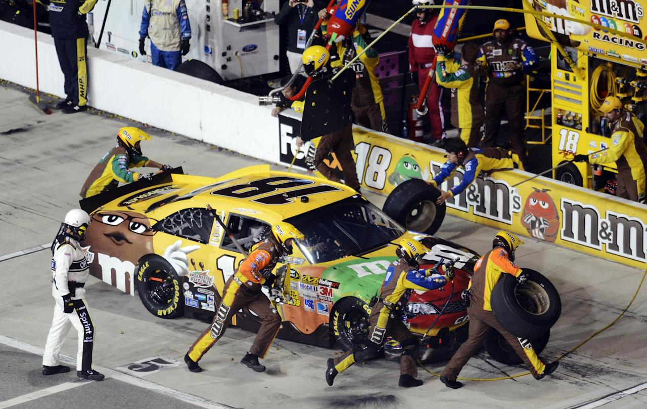 Kyle Busch (18) pits during the NASCAR Sprint Cup Series auto race at Richmond International Raceway in Richmond, Va., Saturday, April 28, 2012. (AP Photo/Scott k. Brown)