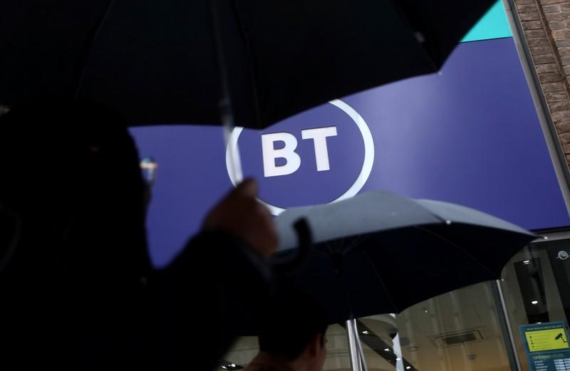 Logo of British Telecom (BT) is displayed outside a store in London