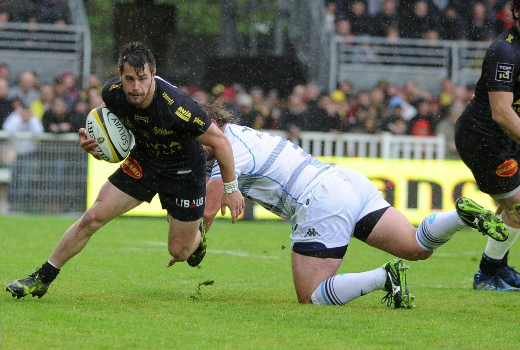 La Rochelle's Arthur Retière is tackled during a French Top 14 rugby union match against Montpellier on April 30, 2017 (AFP Photo/Franck MOREAU)