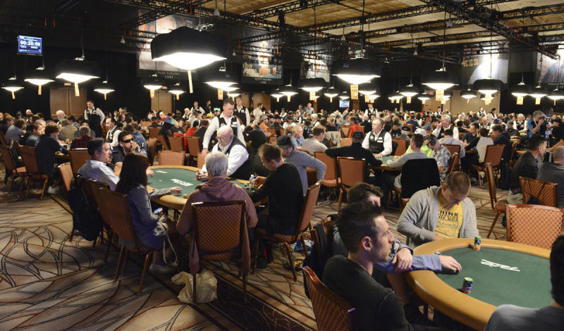In this photo provided by the Las Vegas News Bureau, poker players begin the World Series of Poker $10,000 buy-in Main Event in Las Vegas on Saturday, July 6, 2013. (AP Photo/Las Vegas News Bureau, Brian Jones)