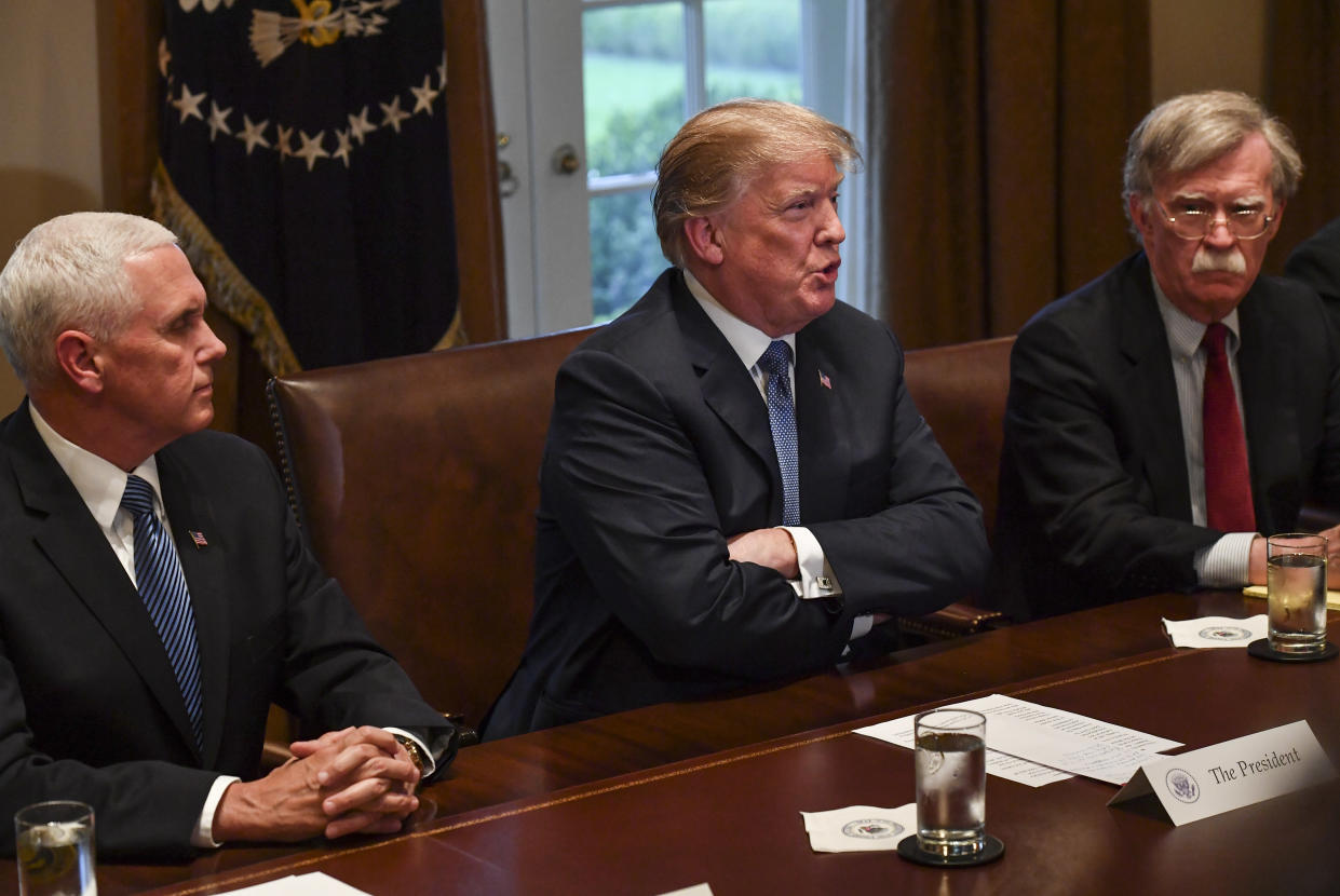 President Donald Trump, flanked by Vice President Mike Pence, left, and national security adviser John Bolton, right, speaks to the media as he meets with senior military leadership in the Cabinet Room of the White House on April 9, 2018, in Washington, D.C. (Photo: Ricky Carioti/Washington Post via Getty Images)