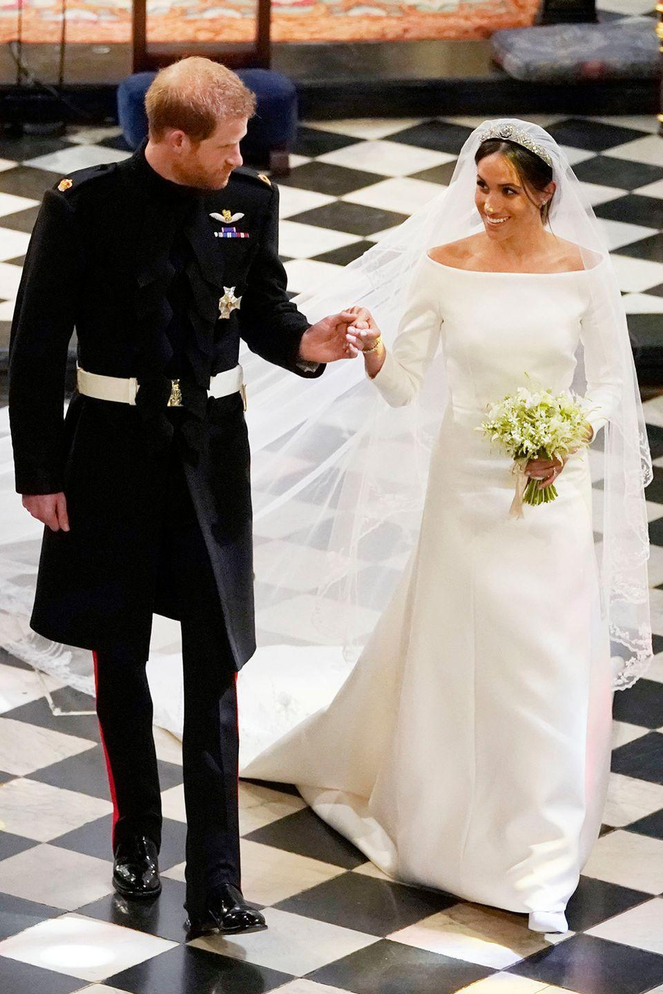 <p>The Duchess of Sussex was truly a regal vision on her wedding day in a striking boatneck Givenchy couture gown by Clare Waight Keller. The gorgeous cathedral-length veil carried symbolic meaning, as Waight Keller captured the flora of 53 Commonwealth countries with beautiful embroidery.</p>