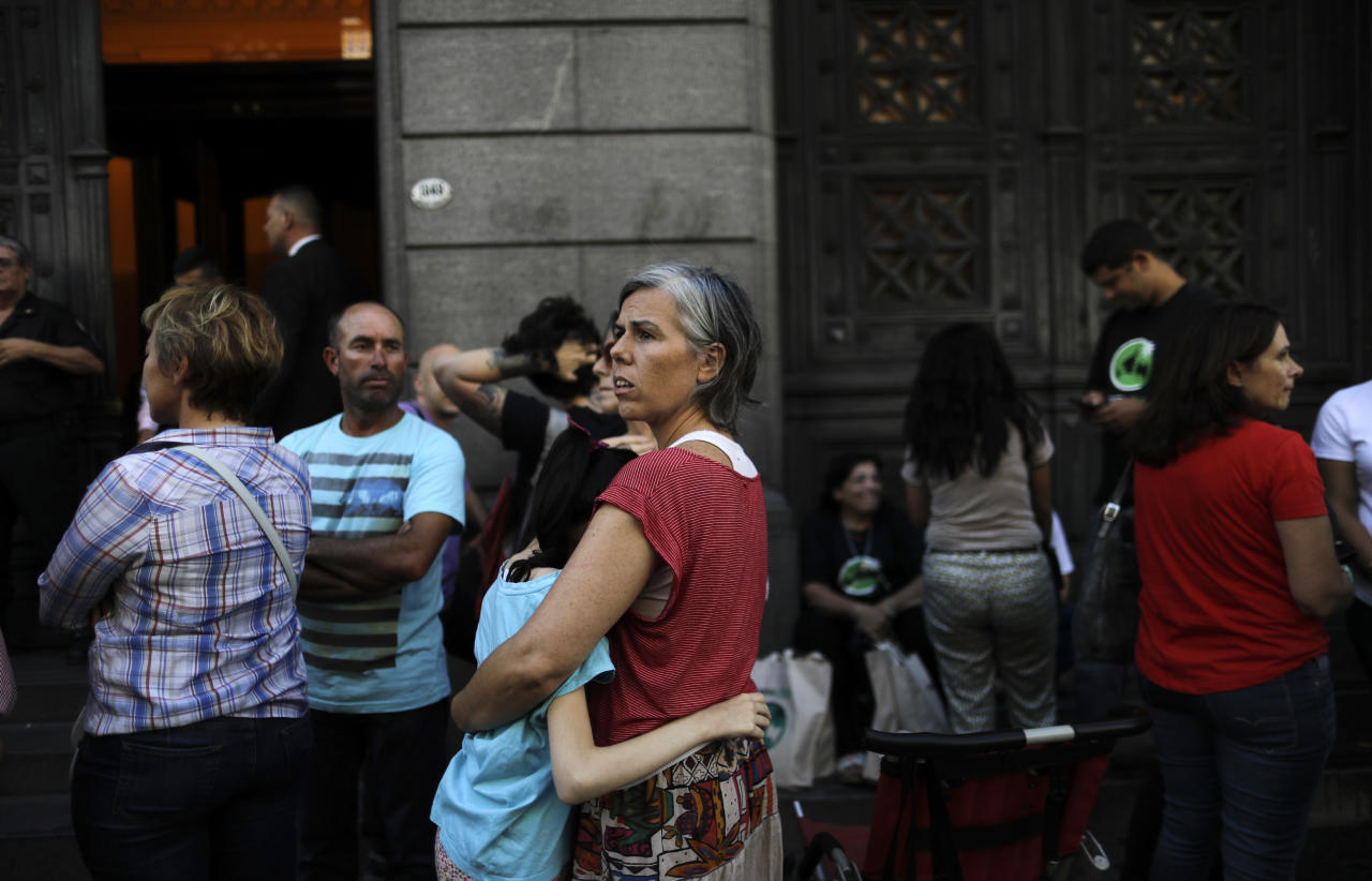 Veronica Fuertes embraces her daughter Violeta Penalba, who suffers epilepsy, and is treated with marijuana, as they stand outside the Senate in Buenos Aires, Argentina, Wednesday, March 29, 2017. The Senate is expected to vote into law the medicinal use of marijuana on Wednesday. (AP Photo/Natacha Pisarenko)