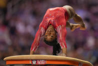 Simone Biles competes on the vault during the women's U.S. Olympic Gymnastics Trials Sunday, June 27, 2021, in St. Louis. (AP Photo/Jeff Roberson)