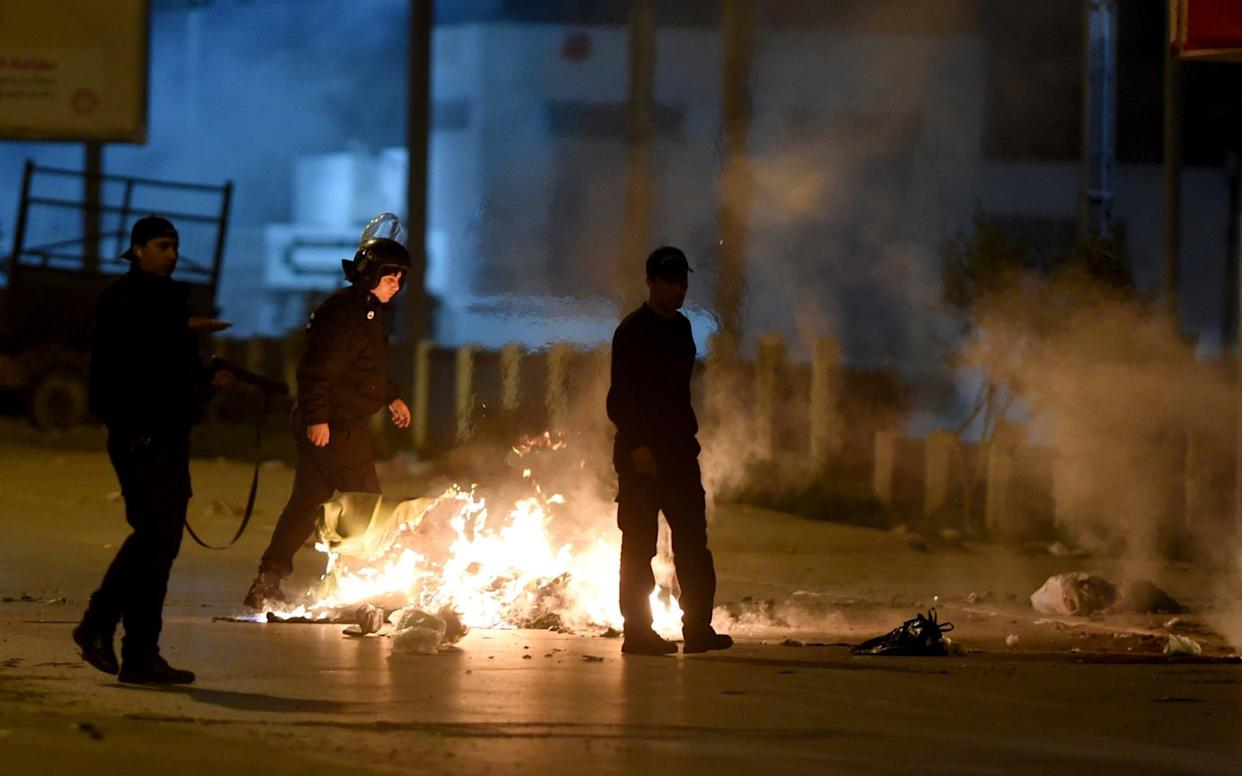 Tunisian security forces in the Ettadhamen on the outskirts of Tunis late on January 10, - AFP