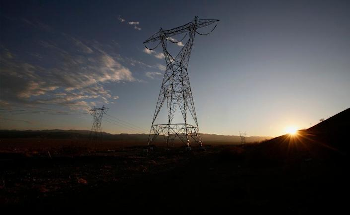 """The Sunrise Powerlink runs through California's Imperial County, near Plaster City. New power lines help facilitate the construction of solar and wind farms, creating high-paying jobs, supporters say. <span class=""""copyright"""">(Peggy Peattie / San Diego Union-Tribune)</span>"""