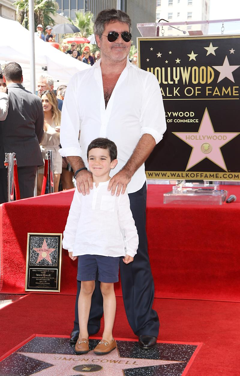Simon Cowell and his son, Eric Cowell attend the ceremony honoring Simon Cowell with a Star on The Hollywood Walk of Fame held on August 22, 2018 in Hollywood, California. (Photo by Michael Tran/FilmMagic)