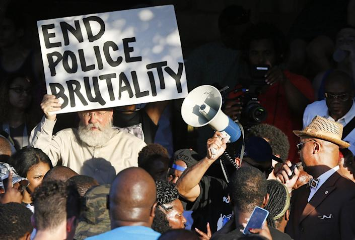 Demonstrators gather near a community pool during a protest earlier this week in response to an incident involving a McKinney police officer. (AP Photo/Ron Jenkins)
