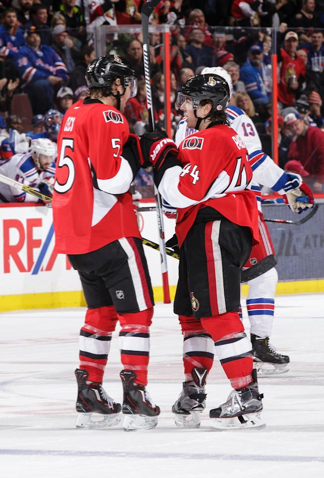 OTTAWA, ON - JANUARY 24: Jean-Gabriel Pageau of the Ottawa Senators celebrates his third period short-handed empty net goal against the New York Rangers with team mate Cody Ceci #5 during an NHL game at Canadian Tire Centre on January 24, 2016 in Ottawa, Ontario, Canada. (Photo by Jana Chytilova/Freestyle Photography/Getty Images)