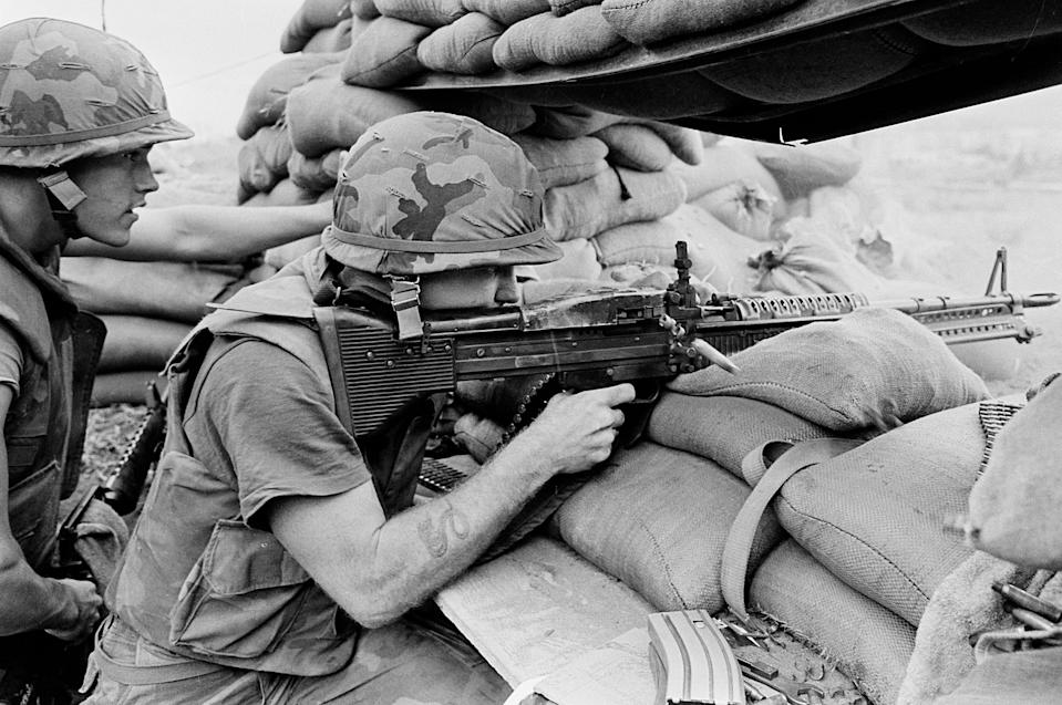 US Marines Lance Corporal David Chapman of Pennsylvania, right, fires from his sandbagged bunker position at Beirut's International Airport