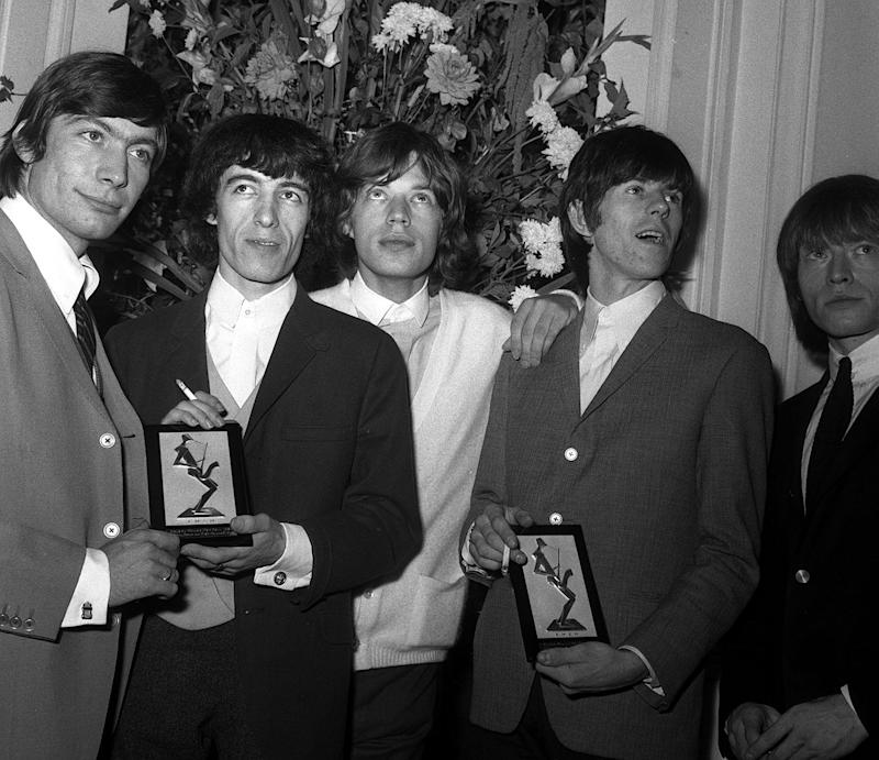 The Rolling Stones, who topped The Beatles, win the vocal/instrumental best group award in the British section of the Melody Maker poll. Pictured at the Variety Club luncheon, at the Savoy Hotel, London. (Photo by PA Images via Getty Images)
