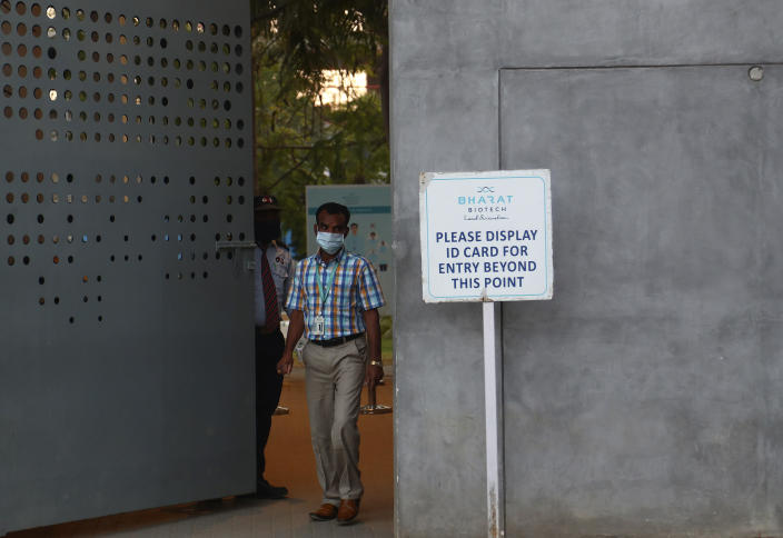 An employee of Bharat Biotech leaves the office campus at the end of the day on the outskirts of Hyderabad, India, Saturday, Jan. 9, 2021. There has been growing apprehensions among health care workers after India took a regulatory shortcut to approve a vaccine by the Indian drugmaker before late clinical trials showed it was effective in preventing illness from coronavirus infections. (AP Photo/Mahesh Kumar A.)