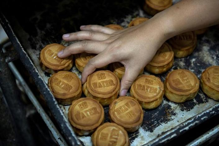 Traditionally given during the mid-autumn festival, mooncakes have been given a protest makeover with popular protest slogans on their crusts (AFP Photo/NICOLAS ASFOURI)