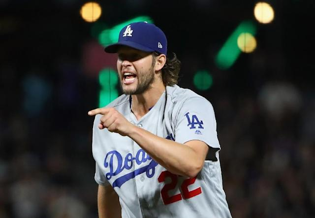 Clayton Kershaw of the Los Angeles Dodgers reacts after he struck out Tim Federowicz of the San Francisco Giants with the bases loaded to end the sixth inning, at AT&T Park in San Francisco, California, on September 12, 2017 (AFP Photo/EZRA SHAW)