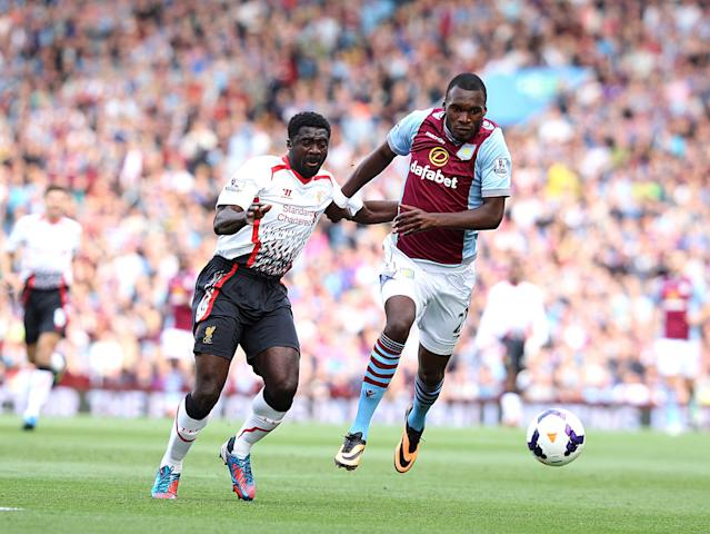 Aston Villa's Christian Benteke (right) and Liverpool's Kolo Toure (left) battle for the ball