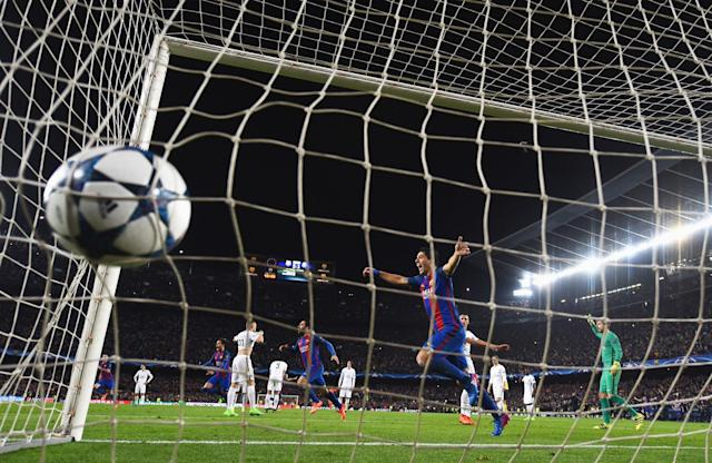 <p>Luis Suarez of Barcelona celebrates as Sergi Roberto of Barcelona scores their sixth goal during the UEFA Champions League Round of 16 second leg match between FC Barcelona and Paris Saint-Germain at Camp Nou on March 8, 2017 in Barcelona, Spain. (Photo by Laurence Griffiths/Getty Images) </p>