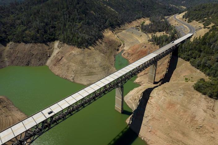 """<div class=""""inline-image__title"""">1233610710</div> <div class=""""inline-image__caption""""><p>A car travels across Enterprise Bridge above Oroville Lake during low water levels in Oroville, California, U.S., on Tuesday, June 22, 2021. </p></div> <div class=""""inline-image__credit"""">Bloomberg/Getty</div>"""