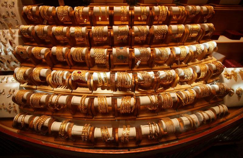Sets of gold bangles are displayed in a showcase of a showroom selling bridal jewellery in Peshawar