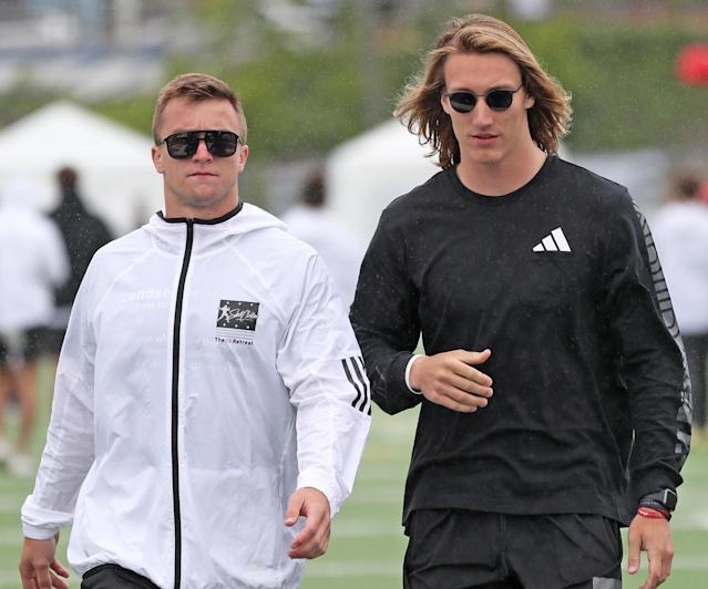 Texas QB Sam Ehlinger (L) and Clemson QB Trevor Lawrence walk with each at Steve Clarkson's Quarterback Retreat. (Photo credit: Kevin Carden)