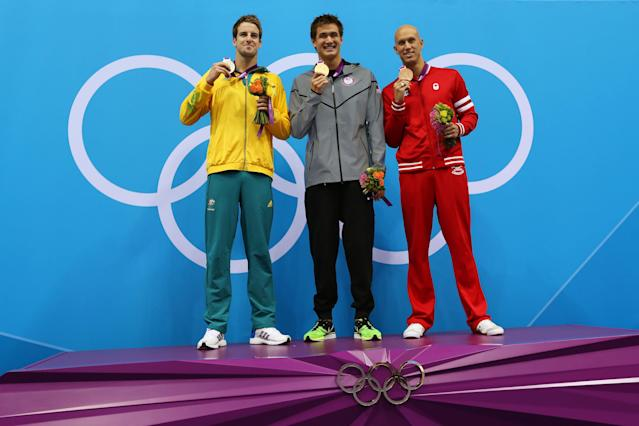 LONDON, ENGLAND - AUGUST 01: (L-R) Silver medalist James Magnussen of Australia, gold medalist Nathan Adrian of the United States and Brent Hayden of Canada celebrate with their medals on the podium during the medal cermony for the Men's 100m Freestyle on Day 5 of the London 2012 Olympic Games at the Aquatics Centre on August 1, 2012 in London, England. (Photo by Clive Rose/Getty Images)