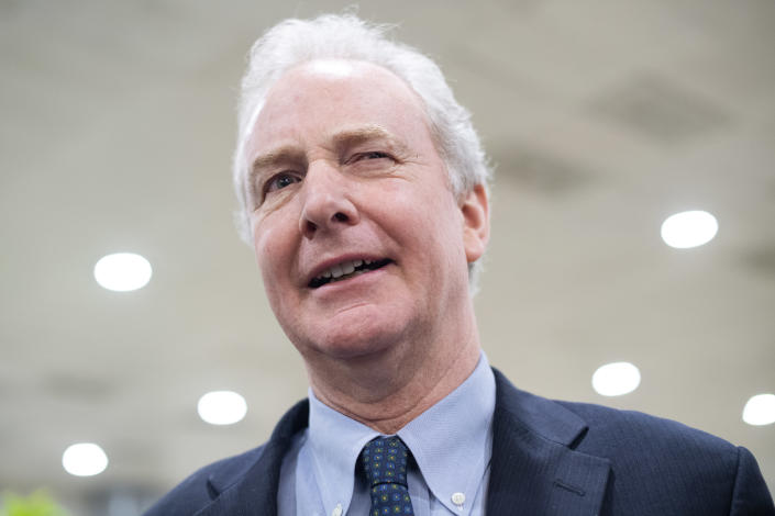 Sen. Chris Van Hollen, D-Md., talks with reporters in the Capitol's senate subway on Thursday, March 12, 2020. (Tom Williams/CQ Roll Call via Getty Images)