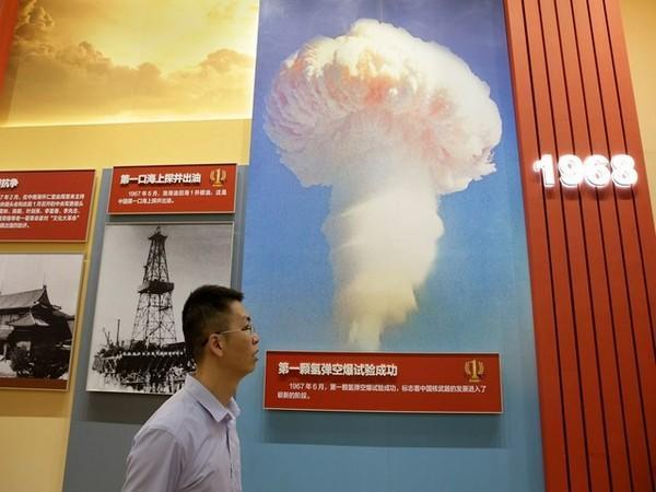 Man walks past an exhibit showing China's first successful hydrogen bomb test in 1967. (Photo Credit - Reuters)