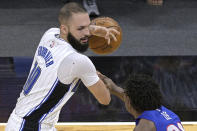 Orlando Magic guard Evan Fournier, left, is fouled by Detroit Pistons guard Saben Lee, right, while setting up for a shot during the second half of an NBA basketball game, Tuesday, Feb. 23, 2021, in Orlando, Fla. (AP Photo/Phelan M. Ebenhack)