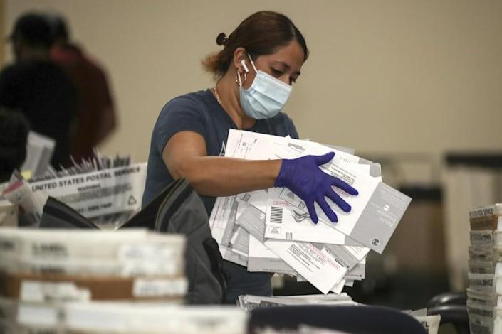 Pomona , CA - September 15: Election worker Yolanda Lavayen unbag ballots for the Sept. 14, recall election at the Los Angeles County Registrar of Voters satellite office at Fairplex on Wednesday, Sept. 15, 2021 in Pomona , CA. (Irfan Khan / Los Angeles Times)