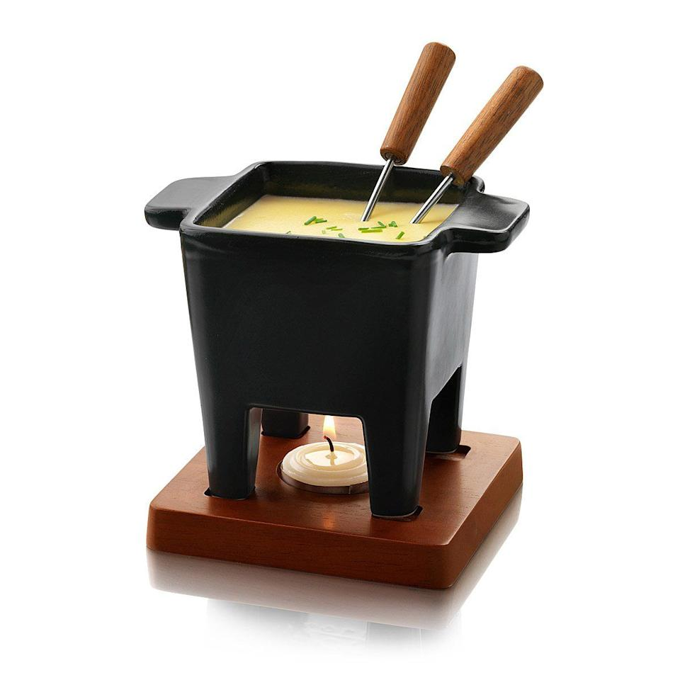"<p>$30</p><p><a rel=""nofollow"" href=""https://www.uncommongoods.com/product/fondue-for-two"">BUY NOW</a></p><p>This fondue pot will give at-home date night a special touch. The only question: cheese or chocolate?</p>"