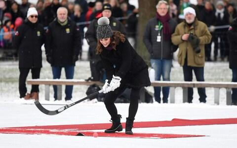 The Duchess of Cambridge taking a bandy ice hockey penalty as she and the Duke of Cambridge at Vasaparken in Stockholm - Credit: Victoria Jones/PA