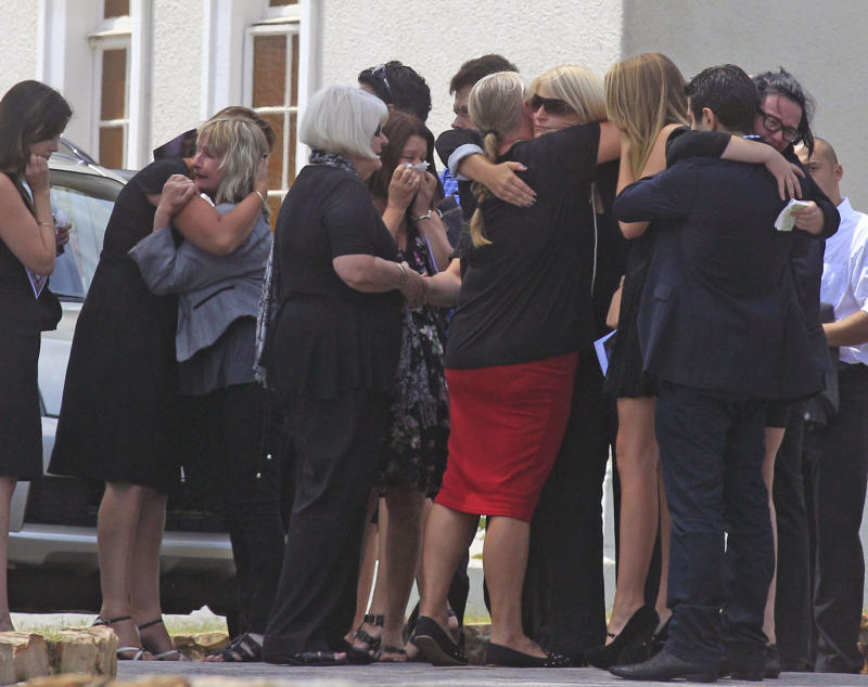 June Steenkamp, third left, the mother of  Reeva Steenkamp, greets people after she and others attend her funeral, in Port Elizabeth, South Africa, Tuesday, Feb. 19, 2013. Olympic athlete Oscar Pistorius is charged with the premeditated murder of Reeva Steenkamp on Valentine's Day. The defense lawyer says it was an accidental shooting. (AP Photo/Schalk van Zuydam)