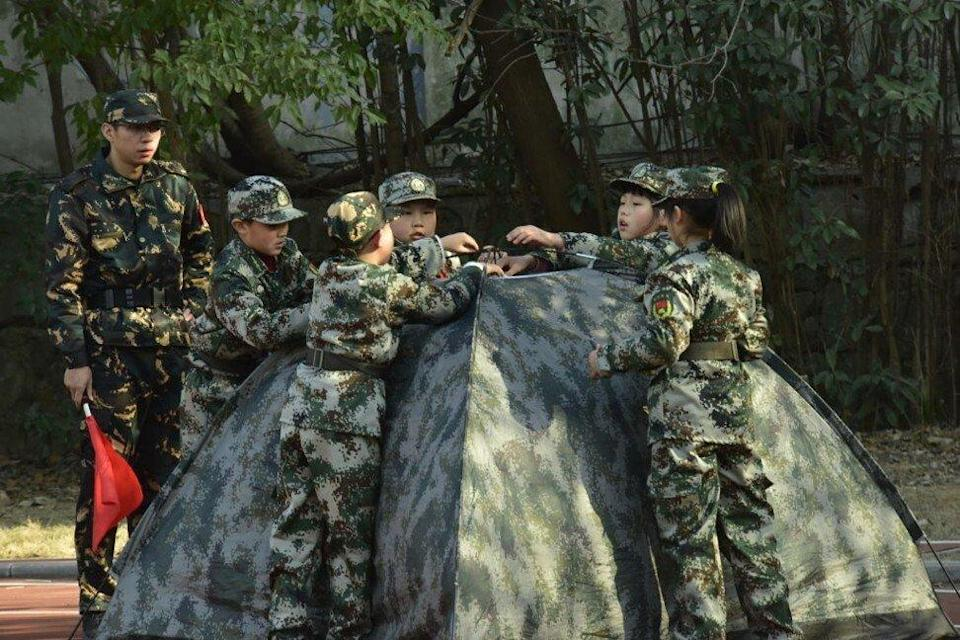 Students of Hefei Huangshan Road Primary School set up a tent during military-style training in Hefei, Anhui province, China. Photo: VCG via Getty Images