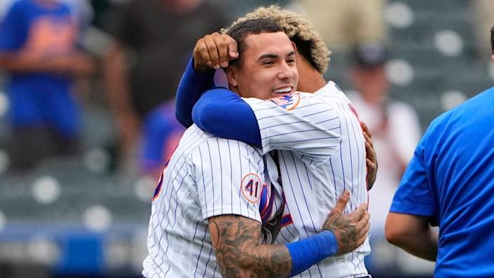 Aug 31, 2021; New York City, New York, USA; New York Mets shortstop Francisco Lindor (12) and New York Mets second baseman Javier Baez (23) embrace to celebrate the victory after the ninth inning against the Miami Marlins at Citi Field.