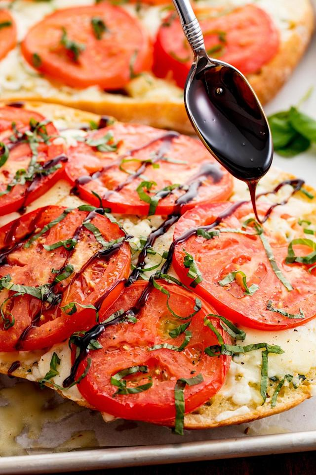 "<p>Don't skimp on the balsamic glaze.</p><p>Get the recipe from <a href=""https://www.delish.com/cooking/recipe-ideas/recipes/a51475/caprese-garlic-bread-recipe/"" target=""_blank"">Delish</a>.</p>"