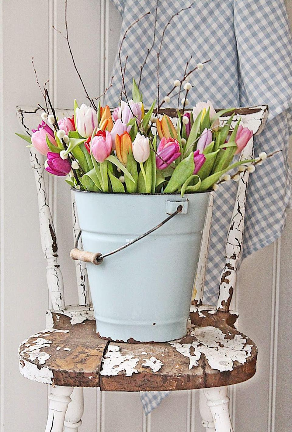 """<p>Arrange multi-colored tulips in unexpected containers, like metal pails, for the ultimate spring vibe. <br><br><em><a href=""""http://vibekedesign.blogspot.nl/2015/02/fargefest.html"""" rel=""""nofollow noopener"""" target=""""_blank"""" data-ylk=""""slk:Get the tutorial from Vibeke Design »"""" class=""""link rapid-noclick-resp"""">Get the tutorial from Vibeke Design »</a></em> </p>"""